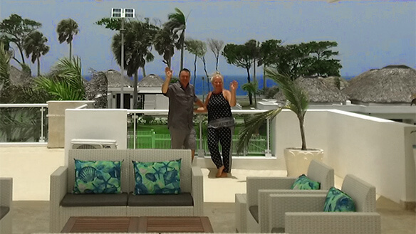 Villa owners on terrace with view of ocean in background