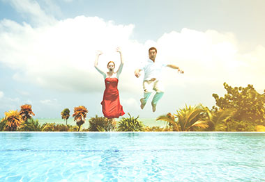 Couple jumping into pool and their more relaxed lifestyle