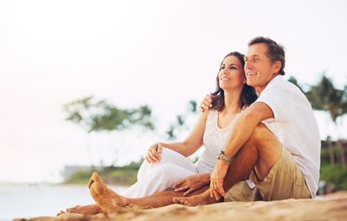 Senior couple on beach in Dominican