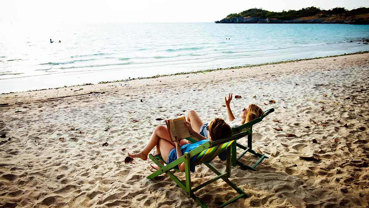 Couple relaxing on beach, now new residents in DR