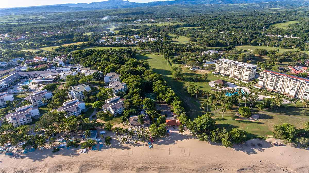View of Playa Dorada from above, showing beach, homes and golf course