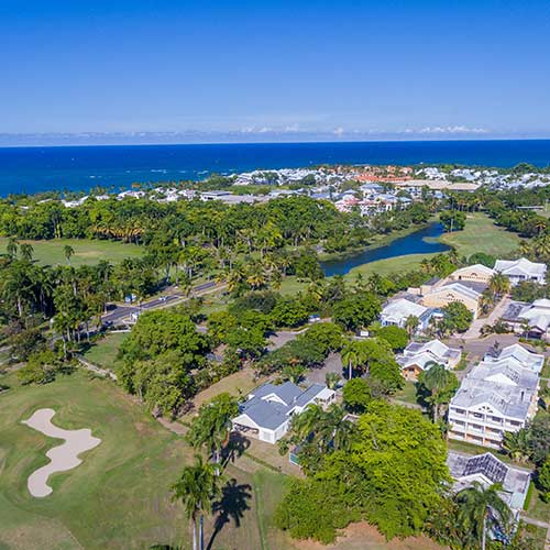 Aerial view of golf course, ocean and GreenOne villa community