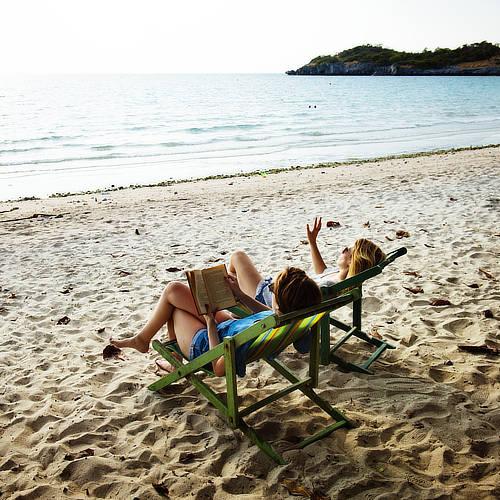 Couple relaxes on sandy beach