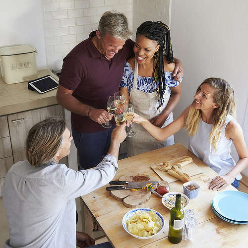 Couples enjoying meal together in villa kitchen