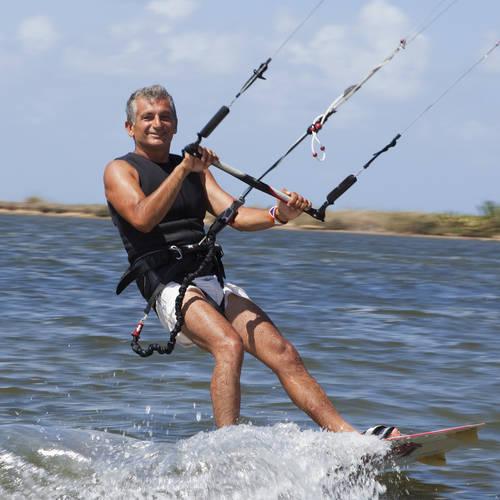 Senior retiree kite surfing near Cabarete Kite Beach in Dominican Republicl