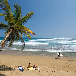 Beachgoers enjoy surf and sun at Puerto Plata